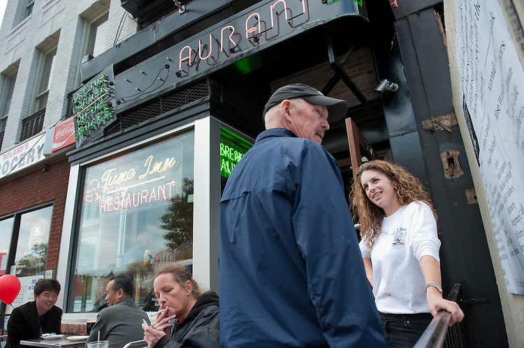 UNITED STATES - NOVEMBER 04:  Lisa Nardelli, owner of the Tune Inn, talks with Stuart Long, former owner of the Hawk and Dove, outside of the Tune Inn on Pennsylvania Avenue, SE, which reopened for business Friday after being closed since June due to a kitchen fire. (Photo By Tom Williams/CQ Roll Call)