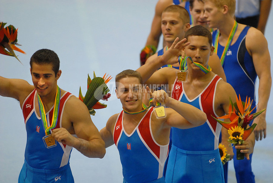 Jul 14, 2007; Rio de Janeiro, Brazil; Athletes from the Puerto Rico mens gymnastics team celebrate after winning the gold medal in the mens team qualification final in the Pan American Games at the Multipurpose Arena in Rio de Janeiro. Mandatory Credit: Mark J. Rebilas-US PRESSWIRE Copyright © 2007 Mark J. Rebilas