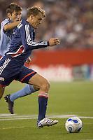 New England Revolution forward Adam Cristman (7) drives on net. The New England Revolution defeated the Colorado Rapids, 1-0, at Gillette Stadium in Foxboro, MA on September 29, 2007.