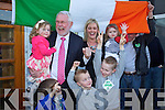 Martin Ferris holding his granddaughter Aoibhin as he arrives at the North Kerry, West Limerick Election 2011 count at the Brandon Hotel Tralee on Saturday.