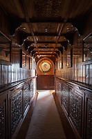 A carved, wood-panelled corridor on the mid level leads to the guest cabins