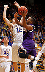SIOUX FALLS, SD - MARCH 9:  Jabari Sandifer #1 from Western Illinois takes the ball to the basket against Brayden Carlson #12 from South Dakota State University in the second half of their quarterfinal game at the 2014 Summit League Tournament Sunday evening in Sioux Falls, SD. (Photo by Dave Eggen/Inertia)