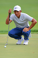 C.T. Pan (TAI) lines up his putt on 2 during round 3 of the Honda Classic, PGA National, Palm Beach Gardens, West Palm Beach, Florida, USA. 2/25/2017.<br /> Picture: Golffile | Ken Murray<br /> <br /> <br /> All photo usage must carry mandatory copyright credit (&copy; Golffile | Ken Murray)