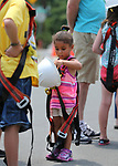 Tamia Julian, 3, tries on safety gear at the Touch-a-Truck event at the Carson City Library in Carson City, Nev., on Saturday, Aug. 5, 2017. <br /> Photo by Cathleen Allison/Nevada Photo Source