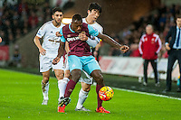 Michail Antonio of West Ham United battles with Ki Sung-Yueng of Swansea during the Barclays Premier League match between Swansea City and West Ham United played at the Liberty Stadium, Swansea  on December 20th 2015
