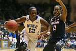 17 December 2013: Duke's Chelsea Gray (12) and UConn's Brianna Banks (13). The Duke University Blue Devils played the University of Connecticut Huskies at Cameron Indoor Stadium in Durham, North Carolina in a 2013-14 NCAA Division I Women's Basketball game. UConn won the game 83-61.