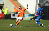 Blackpool's Oliver Turton under pressure from Peterborough United's Louis Reed<br /> <br /> Photographer Kevin Barnes/CameraSport<br /> <br /> The EFL Sky Bet League One - Blackpool v Peterborough United - Saturday 13th April 2019 - Bloomfield Road - Blackpool<br /> <br /> World Copyright &copy; 2019 CameraSport. All rights reserved. 43 Linden Ave. Countesthorpe. Leicester. England. LE8 5PG - Tel: +44 (0) 116 277 4147 - admin@camerasport.com - www.camerasport.com
