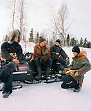 FINLAND, Rovaniemi, husky drivers taking a break.