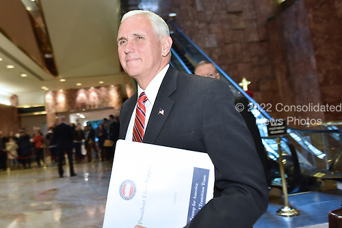 United States Vice President-elect Mike Pence walks through lobby of the Trump Tower in New York, New York, on November 28, 2016. <br /> Credit: Anthony Behar / Pool via CNP