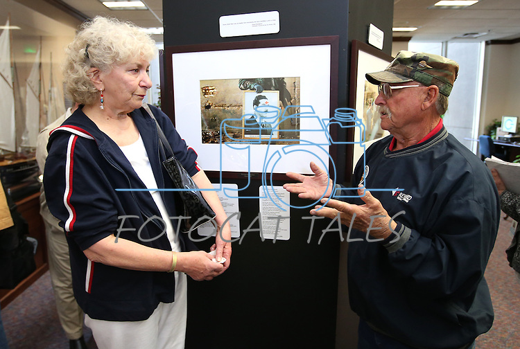 Visitors talk at the Always Lost: A Meditation on War exhibit at the Legislative Building in Carson City, Nev., on Monday, April 6, 2015. <br />