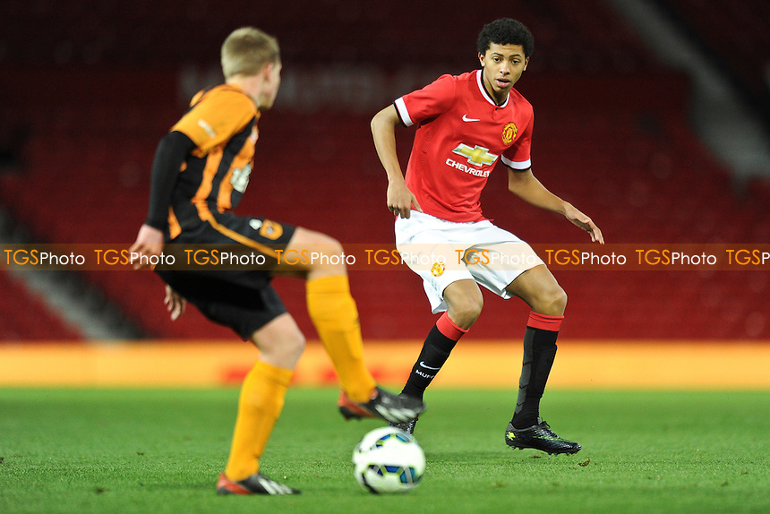 Devonte Redmond of Manchester United closes down Josh Tymon of Hull City - Manchester United Youth vs Hull City Youth - FA Youth Cup 4th Round Football at Old Trafford, Greater Manchester - 13/01/15 - MANDATORY CREDIT: Greig Bertram/TGSPHOTO - Self billing applies where appropriate - contact@tgsphoto.co.uk - NO UNPAID USE