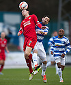 Raith's David Smith gets above Morton's David Graham.