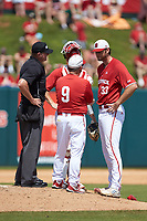 North Carolina State Wolfpack head coach Elliott Avent (9) has a meeting on the mound with starting pitcher \wp33, catcher Patrick Bailey (5), and home plate umpire Mike Jarboe during the game against the Army Black Knights at Doak Field at Dail Park on June 3, 2018 in Raleigh, North Carolina. The Wolfpack defeated the Black Knights 11-1. (Brian Westerholt/Four Seam Images)
