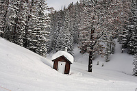 An outhouse stands in the snow at the bottom of the hill at Showdown Ski Area on King's Hill in the Little Belt Mountains near Neihart, Montana, USA.