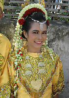 woman  representing her village and region in independance day parade, August 18th, Singaraja, North Bali, archipelago Indonesia, 2009