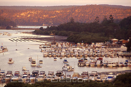 Village of Brooklyn and marina in Sandrook Inlet, an arm of the Hawkesbury River at sunset,  viewed from old Pacific Highway, Sydney, NSW