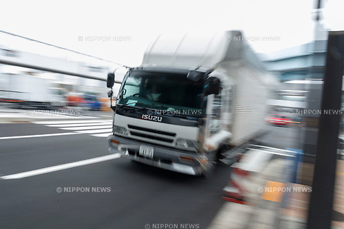A truck transports merchandise at the new Tokyo Metropolitan Central Wholesale Market which opened in Toyosu on October 11, 2018, Tokyo, Japan. The new fish market replaces the famous Tsukiji Fish Market which closed for the last time on Saturday 6th October. The move to Toyosu was delayed for almost 2 years because of fears over toxins found in water below the new market. (Photo by Rodrigo Reyes Marin/AFLO)