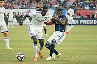 FOXBOROUGH, MA - JULY 27:  Luis Caicedo #27 tackles Lamine Sane #22 at Gillette Stadium on July 27, 2019 in Foxborough, Massachusetts.