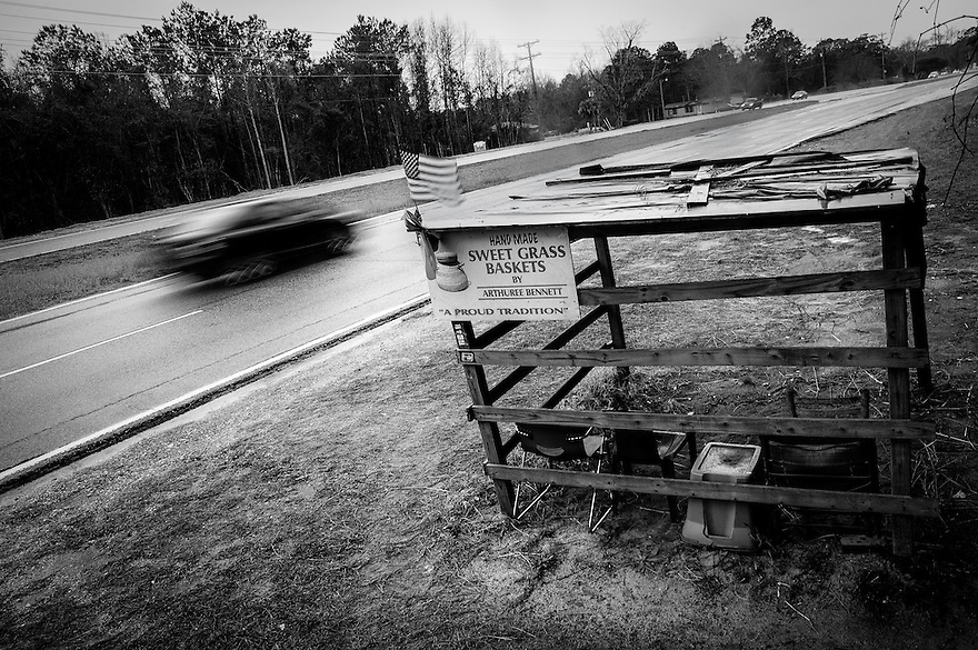 A vacant sweetgrass basket stand sits vacant during a rainy day along U.S. Highway 17 in Mt. Pleasant, SC. The roadside stands are the most visible aspect of the Gullah Geechee culture along U.S. Highway 17. In 2006 a portion of the highway was designated as the Sweetgrass Basket Makers Highway. That same year the sweetgrass baskets became South Carolina's official state craft.