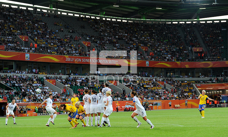 Nilla Fischer (r) of team Sweden scores 2:0 during the FIFA Women's World Cup at the FIFA Stadium in Wolfsburg, Germany on July 6thd, 2011.