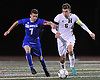 Eric Stewart #7 of Calhoun, left, and Storm Strongin #6 of Hicksville battle for possession during the Nassau County Class AA varsity boys soccer semifinals at Cold Spring Harbor High School on Monday, Oct. 31, 2016. Stewart scored the opening goal in the first half.