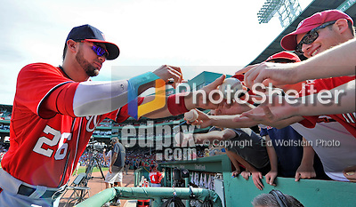9 June 2012: Washington Nationals catcher Jesus Flores signs autographs prior to a game against the Boston Red Sox at Fenway Park in Boston, MA. The Nationals defeated the Red Sox 4-2 in the second game of their 3-game series. Mandatory Credit: Ed Wolfstein Photo