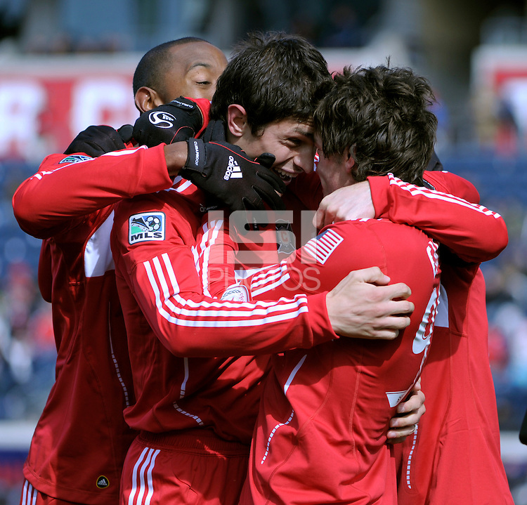 Chicago Fire defender Josip Mikulic (23, left) congratulates forward Diego Chaves (99, right) on Chaves' penalty kick goal  The Chicago Fire defeated Sporting KC 3-2 at Toyota Park in Bridgeview, IL on March 27, 2011.