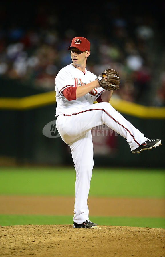 Apr. 17, 2012; Phoenix, AZ, USA; Arizona Diamondbacks pitcher Craig Breslow throws during game against the Pittsburgh Pirates at Chase Field.Mandatory Credit: Mark J. Rebilas-.