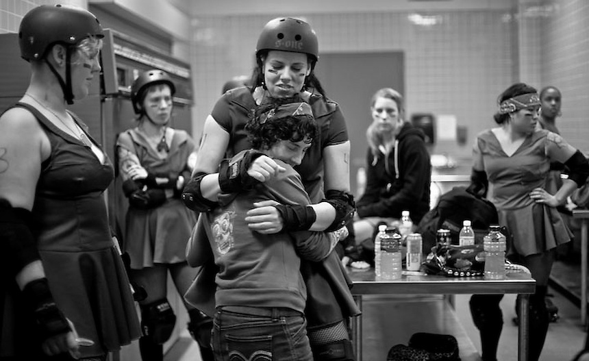 """Kimfectious"" hugs her team captain as the San Francisco ShEvil Dead compete against the Richmond Wrecking Belles at Fort Mason Center in San Francisco, CA on March 14, 2009."