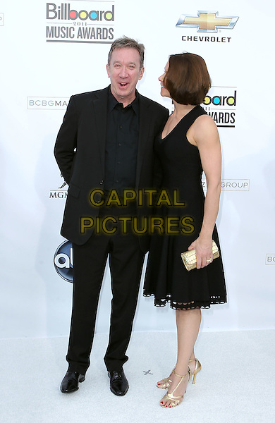 TIM ALLEN & JANE HAJDUK .2011 Billboard Awards arrivals at the MGM Grand Garden Arena, Las Vegas, Nevada, USA..May 22nd, 2011.full length black dress suit side profile married husband wife.CAP/ADM/MJT.© MJT/AdMedia/Capital Pictures.