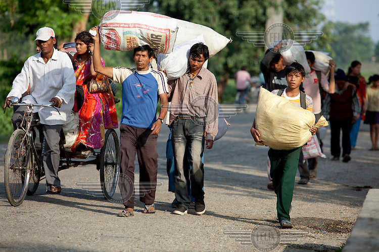 Migrant labourers returning to Nepal from India.