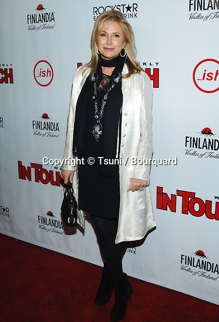 Kathy Hilton-<br /> In Touch - ish Summer Star Party 2008 at the Social Club in Los Angeles.<br /> <br /> full length<br /> eye contact