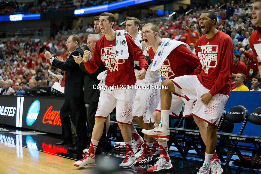 Wisconsin Badgers cheer during a regional semifinal NCAA college basketball tournament gameagainst the Baylor Bears Thursday, March 27, 2014 in Anaheim, California. The Badgers won 69-52. (Photo by David Stluka)