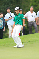 Kevin Na (USA) on the 8th green during Round 3 of the CIMB Classic in the Kuala Lumpur Golf & Country Club on Saturday 1st November 2014.<br /> Picture:  Thos Caffrey / www.golffile.ie