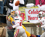 BROOKINGS, SD - NOVEMBER 22:  Jason Schneider #83 from South Dakota State University hauls in a touchdown pass in front of  Jacob Warner #24 from the University of South Dakota in the first half of their game Saturday at Coughlin Alumni Stadium in Brookings. (Photo by Dave Eggen/Inertia)