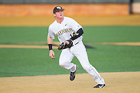 Wake Forest Demon Deacons shortstop Conor Keniry (14) on defense against the Maryland Terrapins at Wake Forest Baseball Park on April 4, 2014 in Winston-Salem, North Carolina.  The Demon Deacons defeated the Terrapins 6-4.  (Brian Westerholt/Four Seam Images)