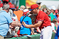 Philadelphia Phillies catcher Matt McBride (33) signs autographs for fans before a Grapefruit League Spring Training game against the Baltimore Orioles on February 28, 2019 at Spectrum Field in Clearwater, Florida.  Orioles tied the Phillies 5-5.  (Mike Janes/Four Seam Images)