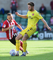 Fleetwood Town's Wes Burns under pressure from Lincoln City's Jack Payne<br /> <br /> Photographer Chris Vaughan/CameraSport<br /> <br /> The EFL Sky Bet League One - Lincoln City v Fleetwood Town - Saturday 31st August 2019 - Sincil Bank - Lincoln<br /> <br /> World Copyright © 2019 CameraSport. All rights reserved. 43 Linden Ave. Countesthorpe. Leicester. England. LE8 5PG - Tel: +44 (0) 116 277 4147 - admin@camerasport.com - www.camerasport.com