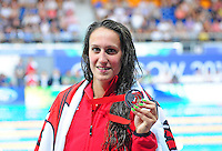 Wales' Georgia Davies poses her silver medal for the women's 100m backstroke final when she finished second<br /> <br /> Photographer Chris Vaughan/CameraSport<br /> <br /> 20th Commonwealth Games - Day 3 - Saturday 26th July 2014 - Swimming - Tollcross International Swimming Centre - Glasgow - UK<br /> <br /> © CameraSport - 43 Linden Ave. Countesthorpe. Leicester. England. LE8 5PG - Tel: +44 (0) 116 277 4147 - admin@camerasport.com - www.camerasport.com