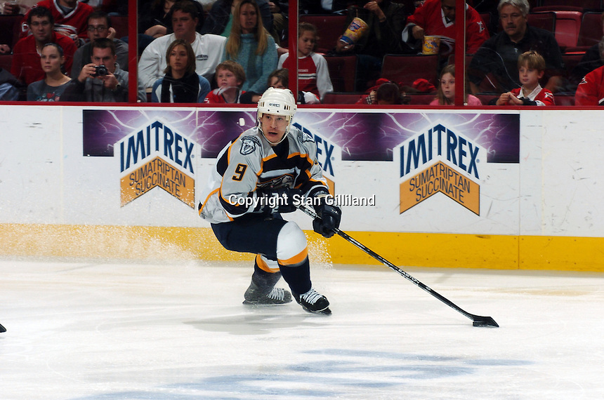 Nashville Predators' Paul Kariya looks to pass against the Carolina Hurricanes Friday, January 13, 2006 in Raleigh, NC. Carolina won 5-4 after a shootout.