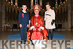 Aughacasla NS pupil Tomas Dean on the day of his Confirmation, pictured with his teacher Ciara Neenan and Msgr. Raymond Browne at St. Mary's Church, Dingle, on Thursday afternoon.