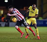 Lincoln City's Tom Pett gets away from Cheltenham Town's Nigel Atangana<br /> <br /> Photographer Andrew Vaughan/CameraSport<br /> <br /> The EFL Sky Bet League Two - Lincoln City v Cheltenham Town - Tuesday 13th February 2018 - Sincil Bank - Lincoln<br /> <br /> World Copyright &copy; 2018 CameraSport. All rights reserved. 43 Linden Ave. Countesthorpe. Leicester. England. LE8 5PG - Tel: +44 (0) 116 277 4147 - admin@camerasport.com - www.camerasport.com
