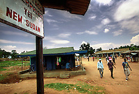 A signboard reading, Yei and New Sudan, the name the SPLA (Sudanese Peoples Liberation Army) have given  to a future independent South Sudan.  The signboard is attached to one of the buildings in the main market street of Yei town.