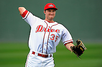 Jantzen Witte (35) of the Greenville Drive warms up before a game against the Charleston RiverDogs on Monday, April 14, 2014, at Fluor Field at the West End in Greenville, South Carolina. Charleston won, 11-3. (Tom Priddy/Four Seam Images)
