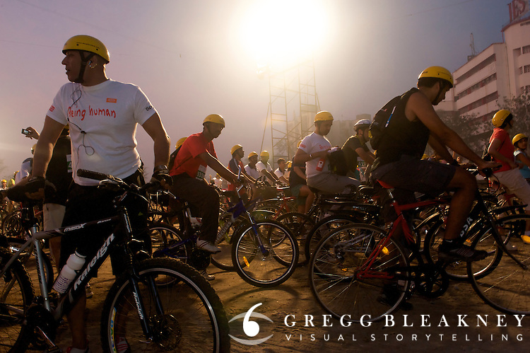 Participants wait at dawn in the holding area at the start of the 2010 Mumbai Cyclothon citizen festival ride - Bombay/Mumbai - India