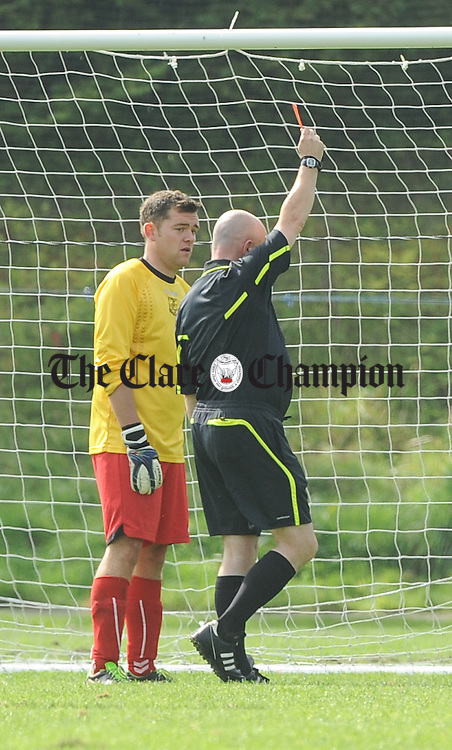 Goalie Kenneth Fielding of Lifford  is red carded by referee Martin O Brien during their game against Ennis Town at Lees Road. Photograph by John Kelly.