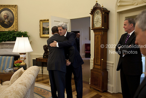 Washington, DC - October 21, 2009 -- United States President Barack Obama hugs U.S. Senator John Kerry (Democrat of Massachusetts), who recently returned from Afghanistan, prior to their meeting in the Oval Office, October 21, 2009. (Official White House Photo by Pete Souza).Mandatory Credit: Pete Souza - White House via CNP