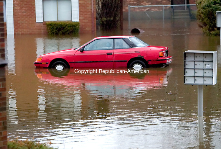 WATERBURY, CT. 16 April 2007-041607SV11--A car sits up to its doors in water on Sharon Road in Waterbury Monday.  Water from an intense storm flooded the road and apartments and were being evacuated.<br /> Steven Valenti Republican-American