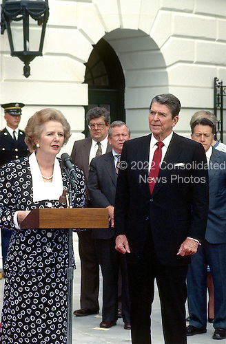 Prime Minister Margaret Thatcher of the United Kingdom, left, makes remarks after visiting United States President Ronald Reagan, right, at the White House in Washington, D.C. on Friday, July 17, 1987.  Thatcher died from a stroke at 87 on Monday, April 8, 2013..Credit: Howard L. Sachs - CNP