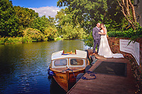 Bride and Groom by Boat on the Great River Ouse at The Barns Hotel in Bedford